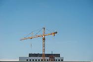 2018 JUNE 19 - Construction crane and blue summer sky, downtown, Seattle, WA, USA. By Richard Walker