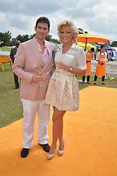 ZAFAR RUSHDIE and his fiance NATALIE COYLE at the Veuve Clicquot Gold Cup Final at Cowdray Park Polo Club, Midhurst, West Sussex on 20th July 2014.
