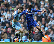 John Stones of Manchester City tussles with Diego Costa of Chelsea during the Premier League match at the Etihad Stadium, Manchester. Picture date: December 3rd, 2016. Pic Simon Bellis/Sportimage