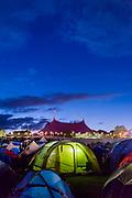 People return to their tents as dawn emerges - The 2017 Glastonbury Festival, Worthy Farm. Glastonbury, 25 June 2017