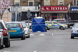 © Licensed to London News Pictures. 22/03/2017. LONDON, UK.  A police forensic tent and police vehicle looking down Bedford Road towards Ilford Lane. A man has died after being shot in Ilford, east London. Police were called to reports of a shooting at the junction of Ilford Lane and Bedford Road in Ilford at 22:10 last night. Emergency services found the victim, a man unconscious with a gunshot wound and he died shortly after.  Photo credit: Vickie Flores/LNP