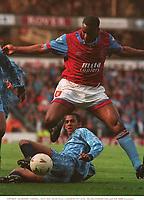 Dalian Atkinson (Aston Villa) tackled by Phil Babb (Coventry). Aston Villa v Coventry City, FA Premier League, 10/4/93. Credit: Colorsport.