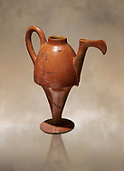 Terra cotta Hittite beaker shaped side spouted pitcher - 1700 BC to 1500BC - Kültepe Kanesh - Museum of Anatolian Civilisations, Ankara, Turkey,  Against a warm art  background .<br /> <br /> If you prefer to buy from our ALAMY STOCK LIBRARY page at https://www.alamy.com/portfolio/paul-williams-funkystock/hittite-art-antiquities.html  - Type Kultepe  into the LOWER SEARCH WITHIN GALLERY box. Refine search by adding background colour, place, museum etc<br /> <br /> Visit our HITTITE PHOTO COLLECTIONS for more photos to download or buy as wall art prints https://funkystock.photoshelter.com/gallery-collection/The-Hittites-Art-Artefacts-Antiquities-Historic-Sites-Pictures-Images-of/C0000NUBSMhSc3Oo