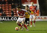 Jordan Cook shields the ball from Louis Reed during the Sky Bet League 1 match between Walsall and Sheffield Utd at the Banks's Stadium, Walsall, England on 17 March 2015. Photo by Alan Franklin.