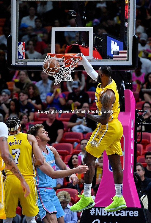 Dec 13, 2019; Miami, FL, USA; Los Angeles Lakers forward LeBron James (23) dunks the ball past against the Miami Heat during the second half at American Airlines Arena. Mandatory Credit: Steve Mitchell