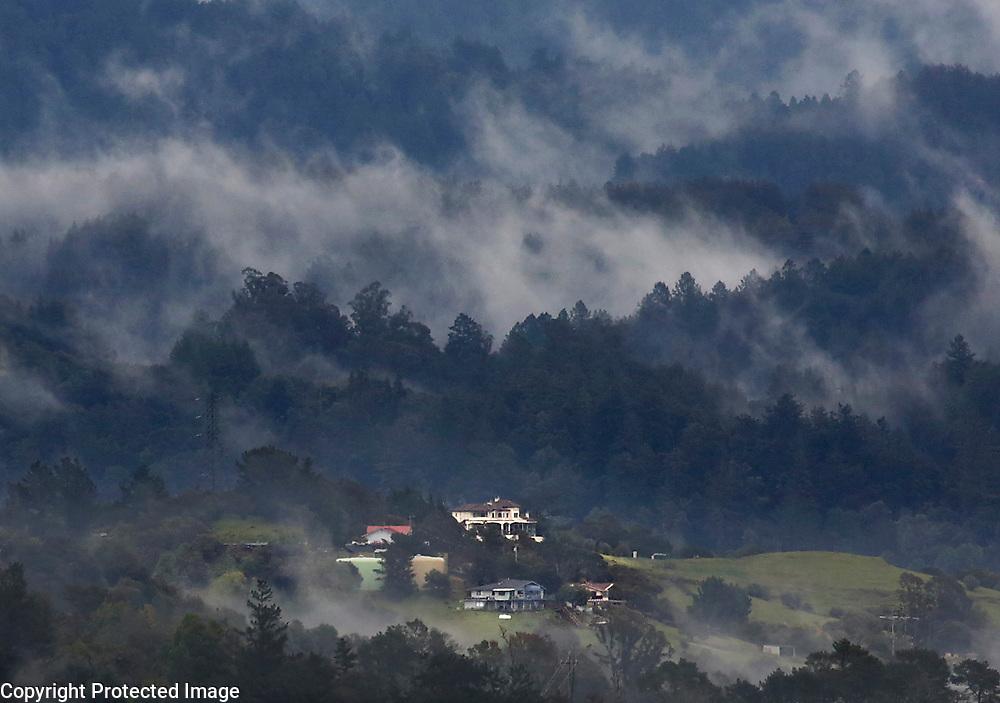 Fog and low lying clouds swirl around the ridges of the Santa Cruz Mountains.<br /> Photo by Shmuel Thaler <br /> shmuel_thaler@yahoo.com www.shmuelthaler.com