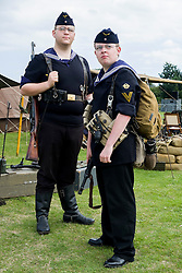 Two world war two re-enactors portraying German Naval Infantry or kriegsmarine Marine Infanterie Division in summer uniform. One is armed with the German Mauser K98 bolt action rifle the other is armed with an MP40 machine Pistol both are wearing ammunition pouches appropriate for the weapon on their belts. <br />