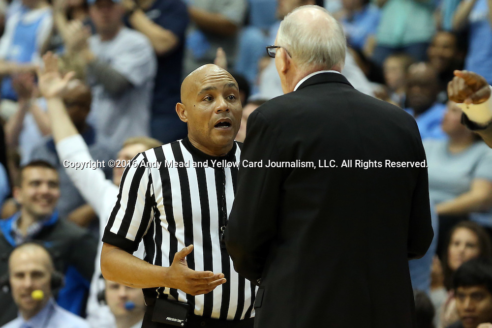 20 February 2016: Referee Bill Covington Jr. (left) explains a call to Miami head coach Jim Larranaga (right). The University of North Carolina Tar Heels hosted the University of Miami Hurricanes at the Dean E. Smith Center in Chapel Hill, North Carolina in a 2015-16 NCAA Division I Men's Basketball game. UNC won the game 96-71.