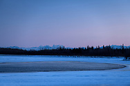 The freeze up is almost complete on the Tanana River in Nenana, Alaska on December 15, 2019. In the distance are Hess Mountain, Mount Deborah, and the Dorsal Fin of the Alaska Range.