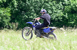 One biker riding ilegally on land at Westood country park seems to spot the police activity before making his escape <br /><br />Police operation against illegal off road biking in the High Green area Sunday <br /><br />Image Copyright Paul David Drabble<br /><br />29 June 2003<br /><br />Copyright  Paul David Drabble<br /><br />[#Beginning of Shooting Data Section]<br />Nikon D1 <br /><br />2003/06/29 12:23:16.1<br /><br />JPEG (8-bit) Fine<br /><br />Image Size:  2000 x 1312<br /><br />Color<br /><br />Lens: 80-200mm f/2.8-2.8<br /><br />Focal Length: 200mm<br /><br />Exposure Mode: Programmed Auto