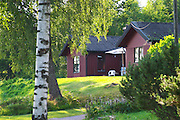 Red country cottage in the forest. Smaland region. Sweden, Europe.