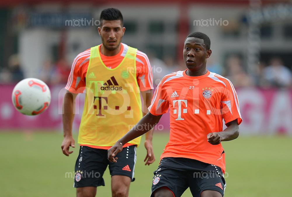 FUSSBALL  1. BUNDESLIGA   SAISON  2012/2013  03.07.2012 Trainingsauftakt beim FC Bayern Muenchen  Emre Can gegen David Alaba (v. li.)