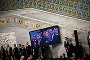 Angela Merkel and Francois Hollande seen on a screen inside City Hall during the Nobel Peace Prize ceremony.