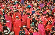 GUATEMALA, FESTIVALS Semana Santa (Easter Week) crowd observing religious procession in Maya Indian village of Zunil