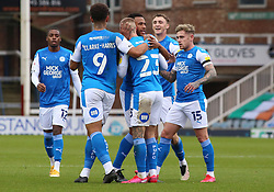 Joe Ward of Peterborough United is congratulated by team-mates after scoring the opening goal of the game - Mandatory by-line: Joe Dent/JMP - 17/10/2020 - FOOTBALL - Weston Homes Stadium - Peterborough, England - Peterborough United v Oxford United - Sky Bet League One