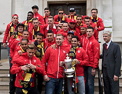 © Licensed to London News Pictures. 31/05/2015. <br /> LONDON, UK. The Arsenal FC first team and manager Arsene Wenger pose for a photograph with the FA Cup trophy in front of Islington Town Hall after the victory parade through the streets of North London to celebrate winning the FA Cup yesterday, London, Sunday 31 May 2015. Photo credit : Hannah McKay/LNP