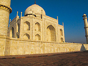 Low angle view of the front of the Taj Mahal with with rich warm light of sunset