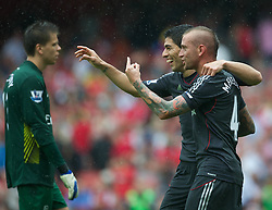 20.08.2011, Emirates Stadium, London, ENG, PL, FC Arsenal vs Liverpool FC, im Bild Liverpool's Raul Meireles gestures with his middle finger as he celebrates with goalscorer Luis Alberto Suarez Diaz after the second goal against Arsenal during the Premiership match at the Emirates Stadium, EXPA Pictures © 2011, PhotoCredit: EXPA/ Propaganda/ D. Rawcliffe *** ATTENTION *** UK OUT!
