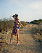 Woman on walkway to beach, Vendicari, Sicily, Italy