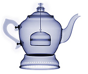 This is an antique aluminum tea pot. The x-ray shows the internal structures that allow the flow of water to extract the tea flavors on a heat source.