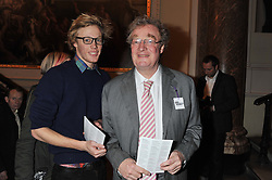 Left to right,  JOE SYKES and CHRISTOPHER SYKES at a private view to celebrate the opening of the Royal Academy's exhibition of work by David Hockney held at The Royal Academy, Burlington House, Piccadilly, London on 17th January 2012.