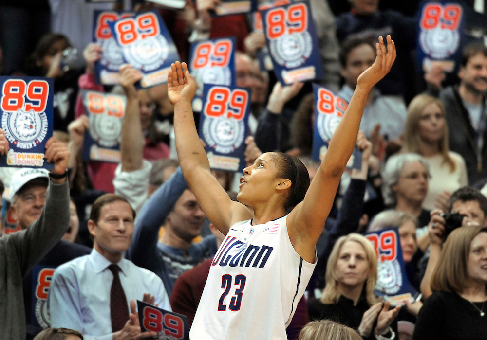 Connecticut forward Maya Moore celebrates in the final seconds of an NCAA college basketball game against Florida State in Hartford, Conn., Tuesday, Dec. 21, 2010. Connecticut beat Florida State 93-62 to to set an NCAA record for consecutive wins, at 89. (AP Photo/Jessica Hill)