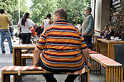 young adult obese man sitting