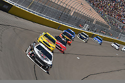March 4, 2018 - Las Vegas, Nevada, U.S. - LAS VEGAS, NV - MARCH 04: Kevin Harvick (4) Stewart-Haas Racing Ford Fusion passes Ryan Blaney (12) Team Penske Ford Fusion for an early lead during the Pennzoil 400 Monster Energy NASCAR Cup Series race on March 4, 2018, at Las Vegas Motor Speedway in Las Vegas, NV. at Las Vegas Motor Speedway in Las Vegas, NV.  (Photo by Michael Allio/Icon Sportswire) (Credit Image: © Michael Allio/Icon SMI via ZUMA Press)