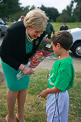 08 November 2014. New Orleans, Louisiana. <br /> Heather Humphreys, Irish Fine Gael politician and the Minister for Arts, Heritage and the Gaeltacht pays a visit to Carrolton Boosters Soccer Club. Humphreys was met by player Joseph Culotta (8yrs).<br /> Photo; Charlie Varley/varleypix.com