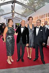 Left to right, ALEXANDRA SHULMAN, GIORGIO ARMANI, his niece ROBERTA ARMANI and JONATHAN NEWHOUSE at British Vogue's Centenary Gala Dinner in Kensington Gardens, London on 23rd May 2016.
