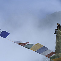 BAFFIN ISLAND, Canada. Tibetan prayers flags bless base camp for Great Sail Peak expedition. (Alex Lowe)