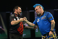 Jonny Clayton congratulates Peter Wright after their match during the Premier League Darts at Marshall Arena, Milton Keynes, United Kingdom on 5 April 2021.