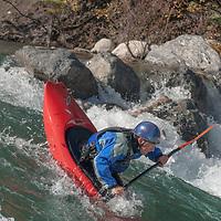 Kayaker David Manning paddles through rapids in the Kananaskis River near Calgary, Alberta, Canada.