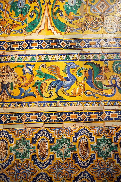 18th century Spanish tiles from the Gothic Palace of the Alcazar of Seville, Spain . The Royal Alcázars of Seville (al-Qasr al-Muriq ) or Alcázar of Seville, is a royal palace in Seville, Spain. It was built by Castilian Christians on the site of an Abbadid Muslim alcazar, or residential fortress.The fortress was destroyed after the Christian conquest of Seville The palace is a preeminent example of Mudéjar architecture in the Iberian Peninsula but features Gothic, Renaissance and Romanesque design elements from previous stages of construction. The upper storeys of the Alcázar are still occupied by the royal family when they are in Seville. <br /> <br /> Visit our SPAIN HISTORIC PLACES PHOTO COLLECTIONS for more photos to download or buy as wall art prints https://funkystock.photoshelter.com/gallery-collection/Pictures-Images-of-Spain-Spanish-Historical-Archaeology-Sites-Museum-Antiquities/C0000EUVhLC3Nbgw <br /> .<br /> Visit our MEDIEVAL PHOTO COLLECTIONS for more   photos  to download or buy as prints https://funkystock.photoshelter.com/gallery-collection/Medieval-Middle-Ages-Historic-Places-Arcaeological-Sites-Pictures-Images-of/C0000B5ZA54_WD0s