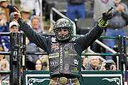 Chase Outlaw reacts after winning a Professional Bull Riders competition at the Sprint Center, in Kansas City, Mo., Sunday, March 24, 2019. With today's victory, Outlaw becomes the number one-ranked rider in the world. (AP Photo/Colin E. Braley)