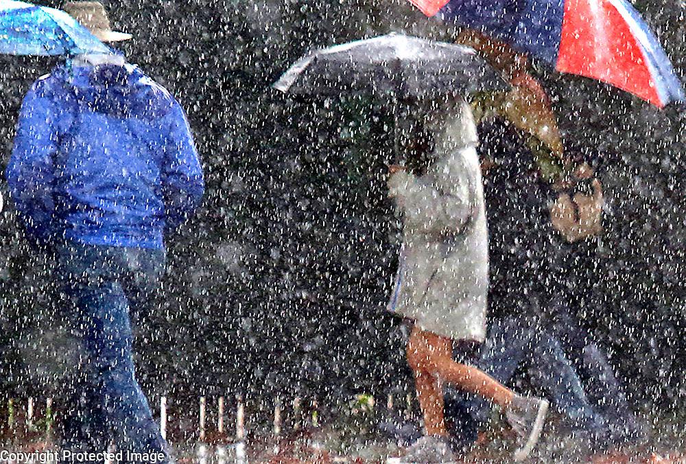 A heavy rain drenches pedestrians on Pacific Avenue in downtown Santa Cruz, California.<br /> Photo by Shmuel Thaler <br /> shmuel_thaler@yahoo.com www.shmuelthaler.com