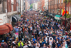 London, June 28th 2014. An elevated view of Old Compton Street as thousands of London's LGBT community and their supporters throw a vast party in Soho.