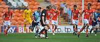 Referee Ollie Yates impedes the progress of Blackpool's Brad Potts<br /> <br /> Photographer Bethany Hankey/CameraSport<br /> <br /> Football - The EFL Sky Bet League Two - Blackpool v Wycombe Wanderers - Saturday 20 August 2016 - Bloomfield Road - Blackpool<br /> <br /> World Copyright © 2016 CameraSport. All rights reserved. 43 Linden Ave. Countesthorpe. Leicester. England. LE8 5PG - Tel: +44 (0) 116 277 4147 - admin@camerasport.com - www.camerasport.com