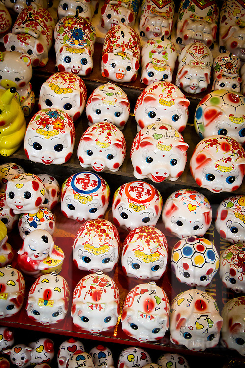 Piggy banks lined-up for sale at a shop in Hanoi, Vietnam, Asia