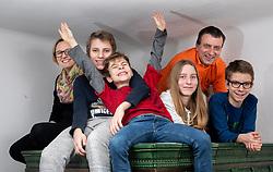Family Obadic posing on home stairs, on February 7, 2021 in Skofja Loka, Slovenia.  Photo by Vid Ponikvar / Sportida