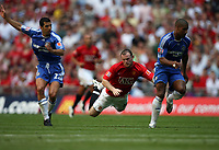 Photo: Rich Eaton.<br /> <br /> Manchester United v Chelsea. FA Community Shield. 05/08/2007. Man United's Wayne Rooney (c0 goes flying after a challenge by Tal Ben Haim (l) of Chelsea.