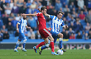 Cardiff City midfielder Joe Ralls and Brighton central midfielder, Dale Stephens battles for possession during the Sky Bet Championship match between Brighton and Hove Albion and Cardiff City at the American Express Community Stadium, Brighton and Hove, England on 3 October 2015.