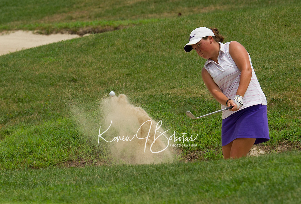 Britney Hamilton takes a shot from the sandtrap Saturday afternoon during the Symetra LPGA Tour at Beaver Meadows Golf Course.  (Karen Bobotas/for the Concord Monitor)