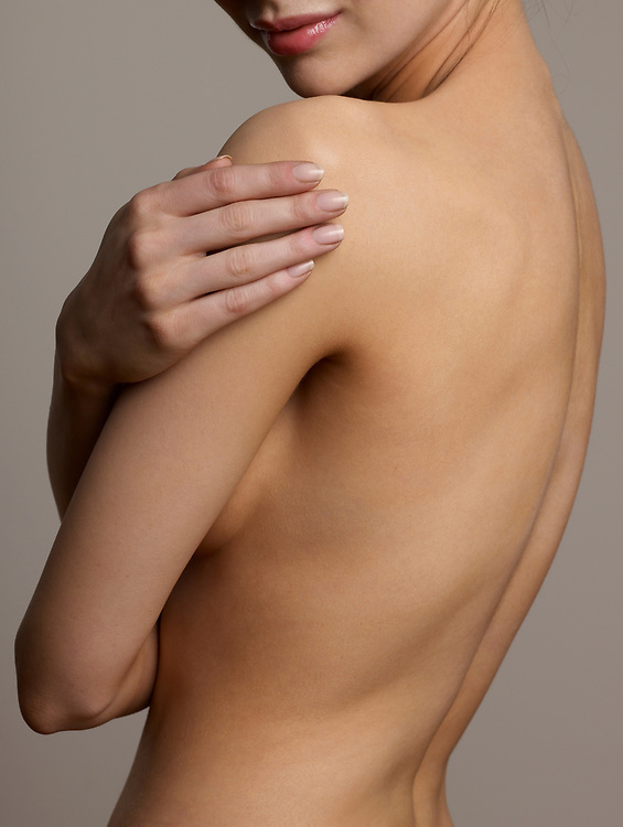 Woman caressing her beautiful and graceful nude torso