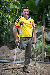 16 November 2018, San José de León, Mutatá, Antioquia, Colombia: 48-year-old Ivan walks on crutches as he is missing a leg. He lived 31 years as a FARC guerilla combatant, before settling in San José de León after the 2016 peace treaty in Colombia. Following the 2016 peace treaty between FARC and the Colombian government, a group of ex-combatant families have purchased and now cultivate 36 hectares of land in the territory of San José de León, municipality of Mutatá in Antioquia, Colombia. A group of 27 families first purchased the lot of land in San José de León, moving in from nearby Córdoba to settle alongside the 50-or-so families of farmers already living in the area. Today, 50 ex-combatant families live in the emerging community, which hosts a small restaurant, various committees for community organization and development, and which cultivates the land through agriculture, poultry and fish farming. Though the community has come a long way, many challenges remain on the way towards peace and reconciliation. The two-year-old community, which does not yet have a name of its own, is located in the territory of San José de León in Urabá, northwest Colombia, a strategically important corridor for trade into Central America, with resulting drug trafficking and arms trade still keeping armed groups active in the area. Many ex-combatants face trauma and insecurity, and a lack of fulfilment by the Colombian government in transition of land ownership to FARC members makes the situation delicate. Through the project De la Guerra a la Paz ('From War to Peace'), the Evangelical Lutheran Church of Colombia accompanies three communities in the Antioquia region, offering support both to ex-combatants and to the communities they now live alongside, as they reintegrate into society. Supporting a total of more than 300 families, the project seeks to alleviate the risk of re-victimization, or relapse into violent conflict.