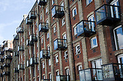 Old industrial maltings building converted into housing at Mistley, Essex, England