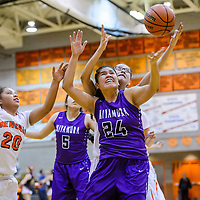 Miyamura Patriot Destiny Lee (24) and Gallup Bengal Ashley Antone (1) compete for a rebound Monday at Gallup High School.