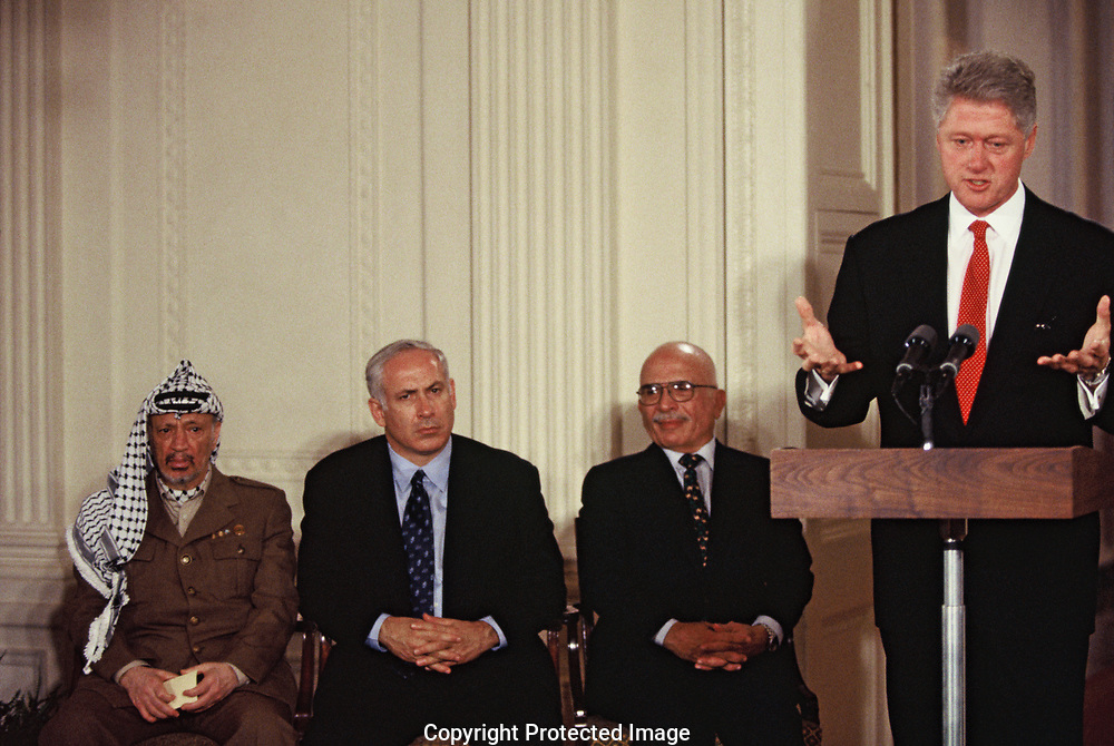 Washington DC 1996/10/2  President William Clinton at the Middle East Peace Conference in East Room of the White House. Left to right:  Yasir Arafat,Israeli Prime Minister Benjamin Netanyahu, and King Hussein,Jordan. <br />Photo by Dennis Brack