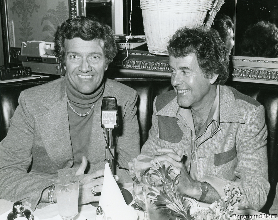 1978 Radio commentator and interviewer, Gregg Hunter, seen interviewing ? during his KIEV radio show at the Brown Derby Restaurant on Vine St. in Hollywood