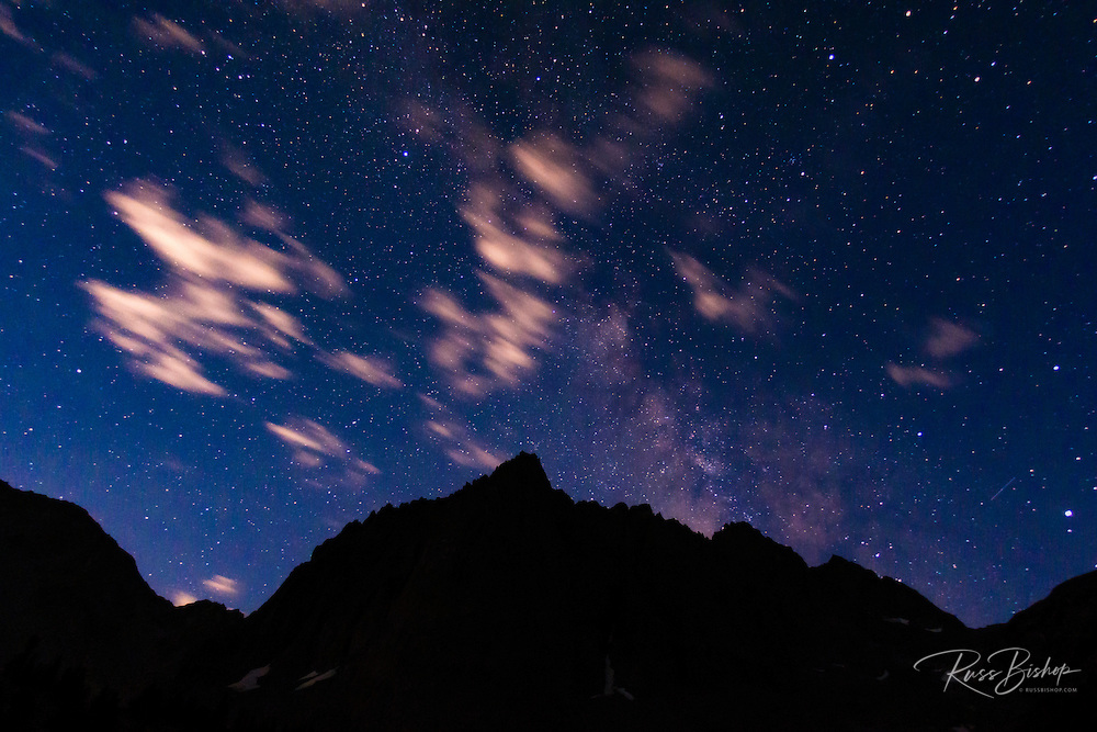 The Milky Way and clouds over the Palisades, John Muir Wilderness, Sierra Nevada Mountains, California USA